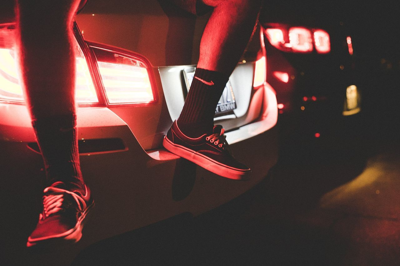 low section, human leg, shoe, real people, red, one person, lifestyles, indoors, women, illuminated, night, close-up, people