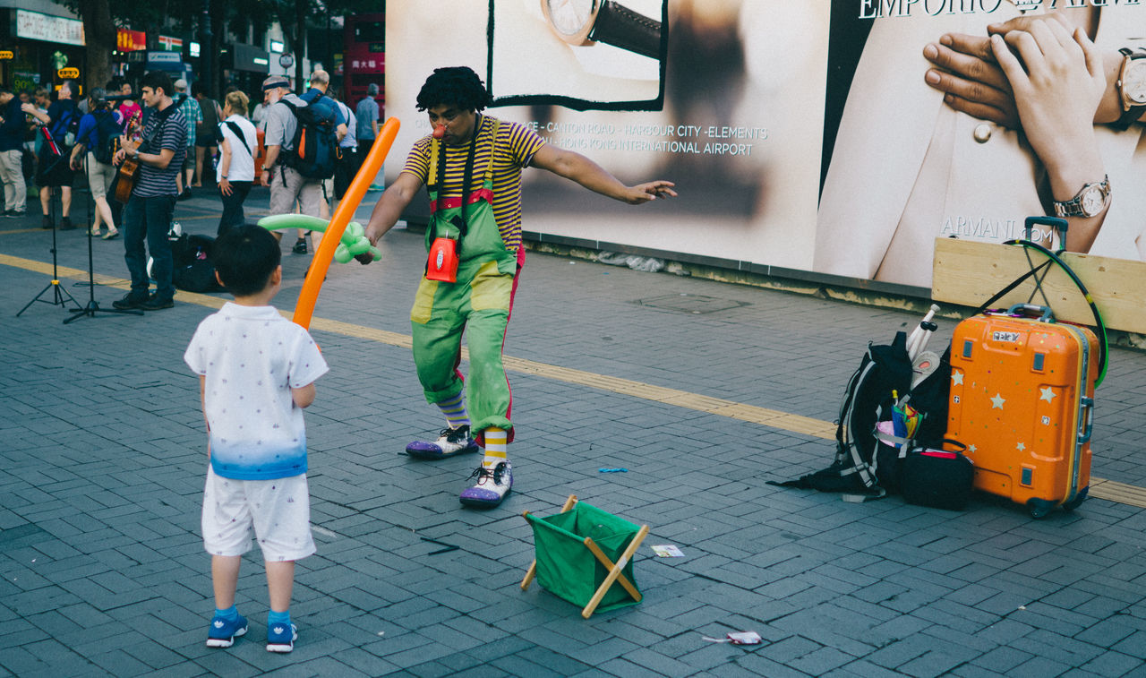 Fencing on the street Fencing Adult Clown Day Full Length Fun Funny Faces Happiness Human Body Part Outdoors People Rear View Togetherness Women