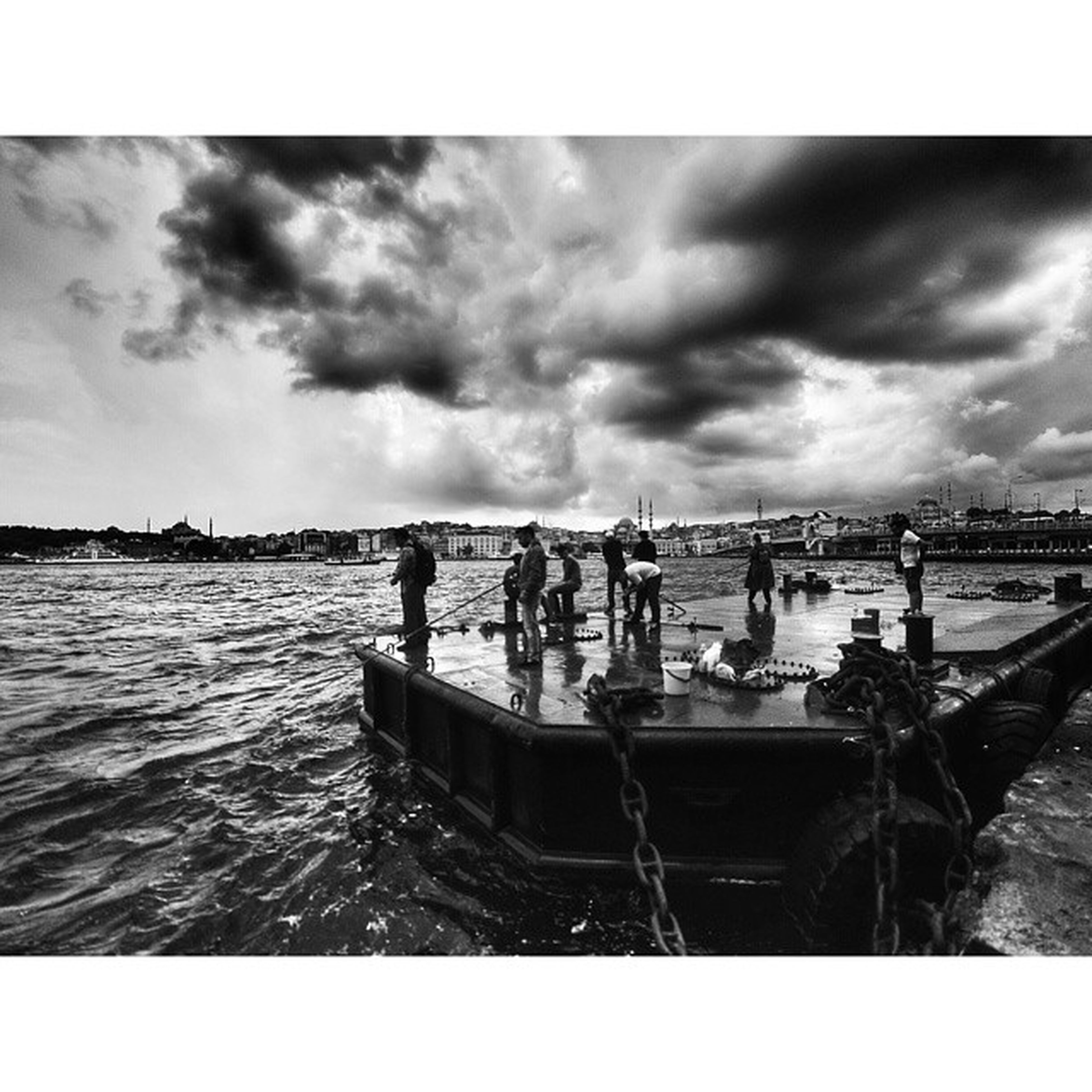 water, sky, cloud - sky, transfer print, sea, nautical vessel, cloudy, auto post production filter, transportation, boat, mode of transport, cloud, overcast, moored, men, nature, weather, waterfront, day