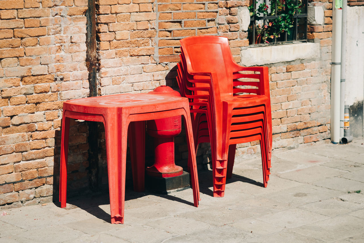 prepared for the masses Architecture Brick Wall Building Exterior Built Structure Chair Day No People Outdoors Red Seat Threedaysvenice Travel Travel Destinations Venice