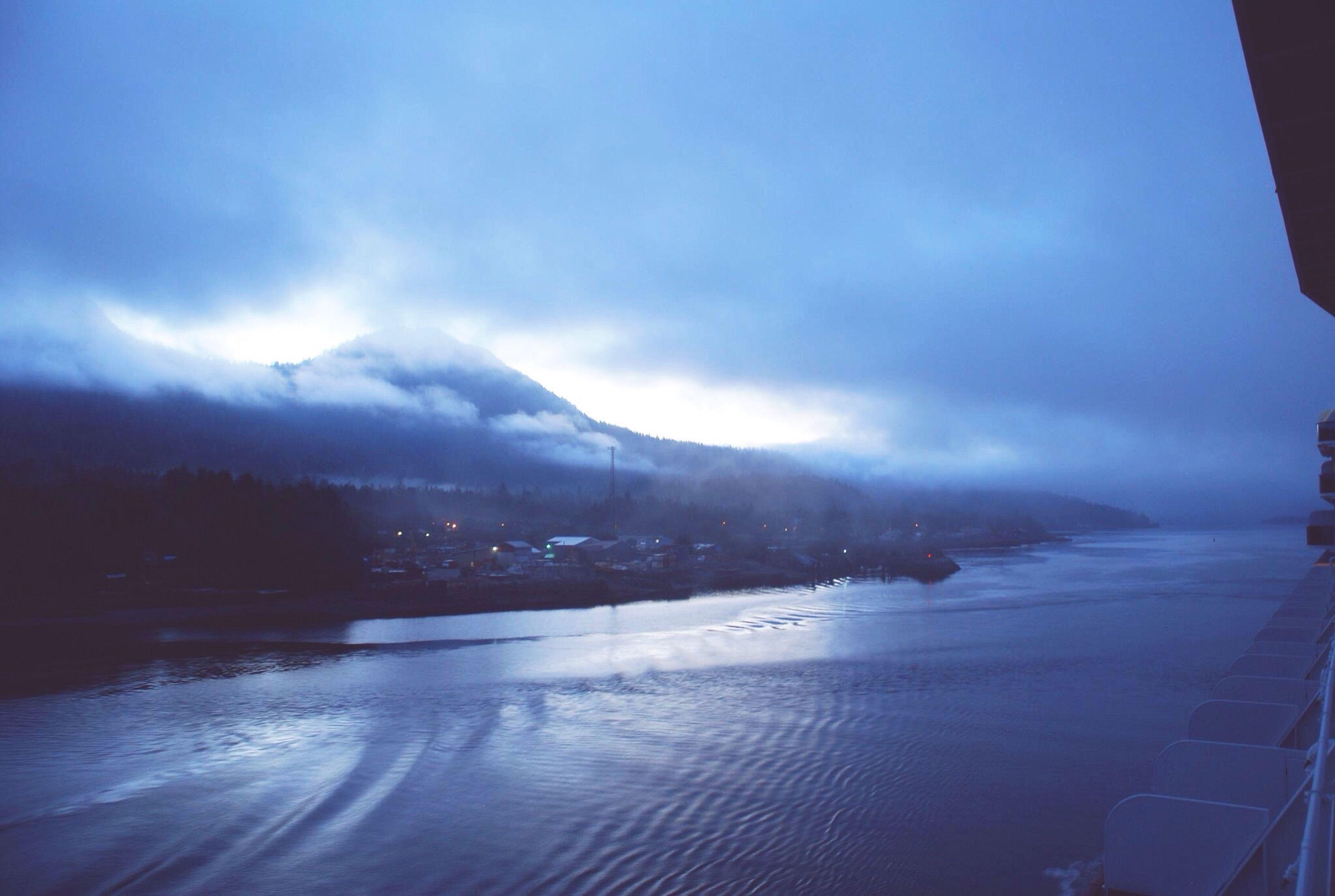 sky, water, scenics, cloud - sky, beauty in nature, tranquil scene, tranquility, nature, blue, cloud, cloudy, mountain, weather, idyllic, outdoors, no people, landscape, day, non-urban scene, remote, calm, coastline, travel destinations, majestic, overcast