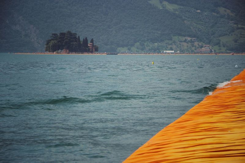 Walking on the Floating piers   Original Experiences Lake Fine Art Still Life The Floating Piers Edge Of Imagination Getting Inspired The Essence Of Summer Close-up Christo And The Floating Piers Feel The Journey Sunshine Tailored To You Point Of View 43 Golden Moments Showcase July Golden Moments  Lago D'Iseo EyeEm Italy  