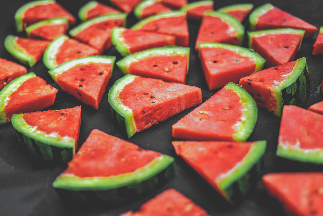watermelon is so summer! Appetizer Blurry On Purpose Chopped Close-up Depht Of Field Eye4photography  EyeEm Best Shots Food Fresh Freshness Fruit In A Row Large Group Of Objects Organic Ready-to-eat Red SLICE Summer Views Summertime Vegetarian Food Vibrant Color Watermelon Watermelon🍉