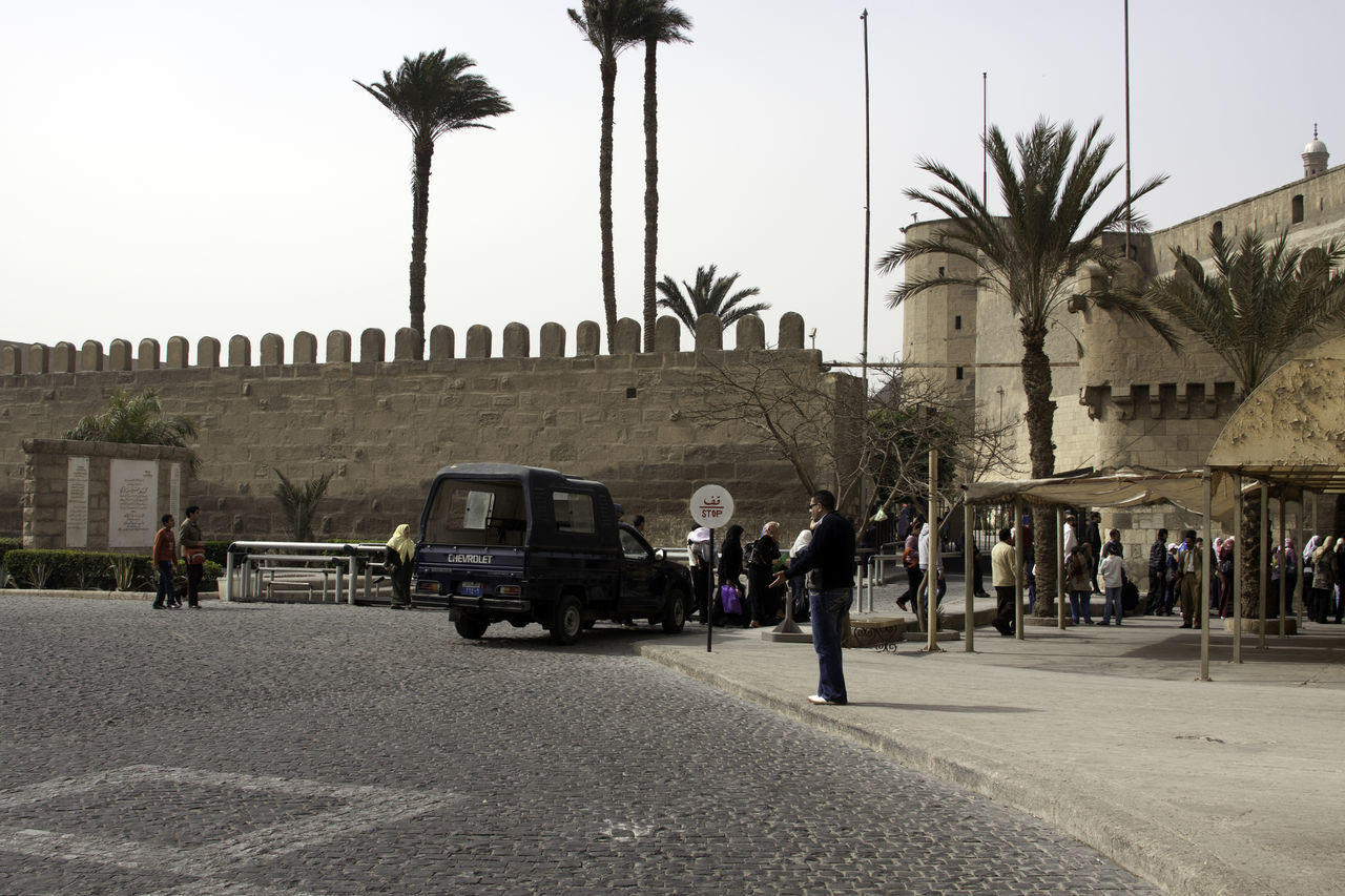 People walking towards the Saladin Citadel, fairly close to the parking at the location. Like many of the tourist locations in Egypt, the parking is located at some distance away, and one needs to walk over a distance, and through a security setup (because of the past history of terrorist attacks on tourists) to get inside the monument. Palm trees are often found in Egypt, since they seem to do well in the hot climate. Architecture Cairo Cairo Egypt Egypt Historical Building Large Group Of People Outdoors Palm Tree People Saladin Citadel Tourist Attraction  Tree