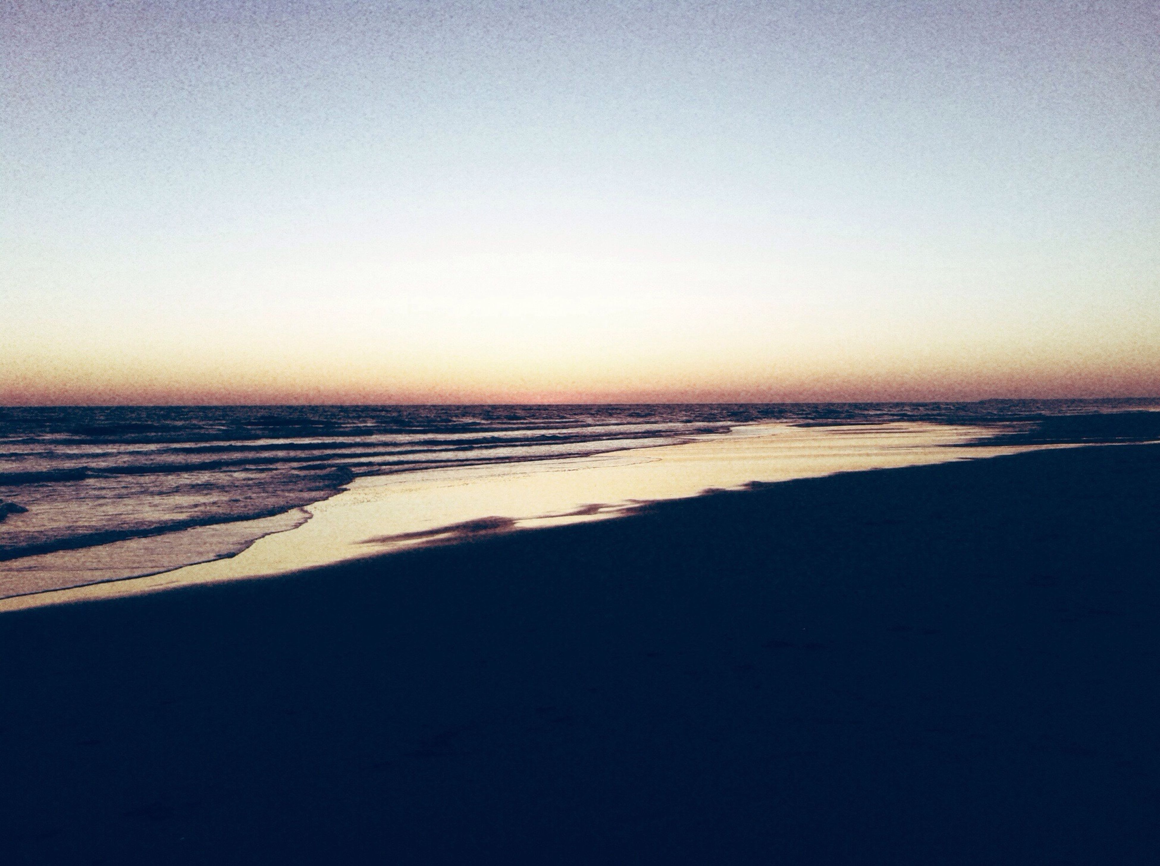sea, horizon over water, copy space, clear sky, water, beach, tranquil scene, scenics, tranquility, beauty in nature, shore, sunset, nature, idyllic, sand, wave, calm, coastline, sky, remote