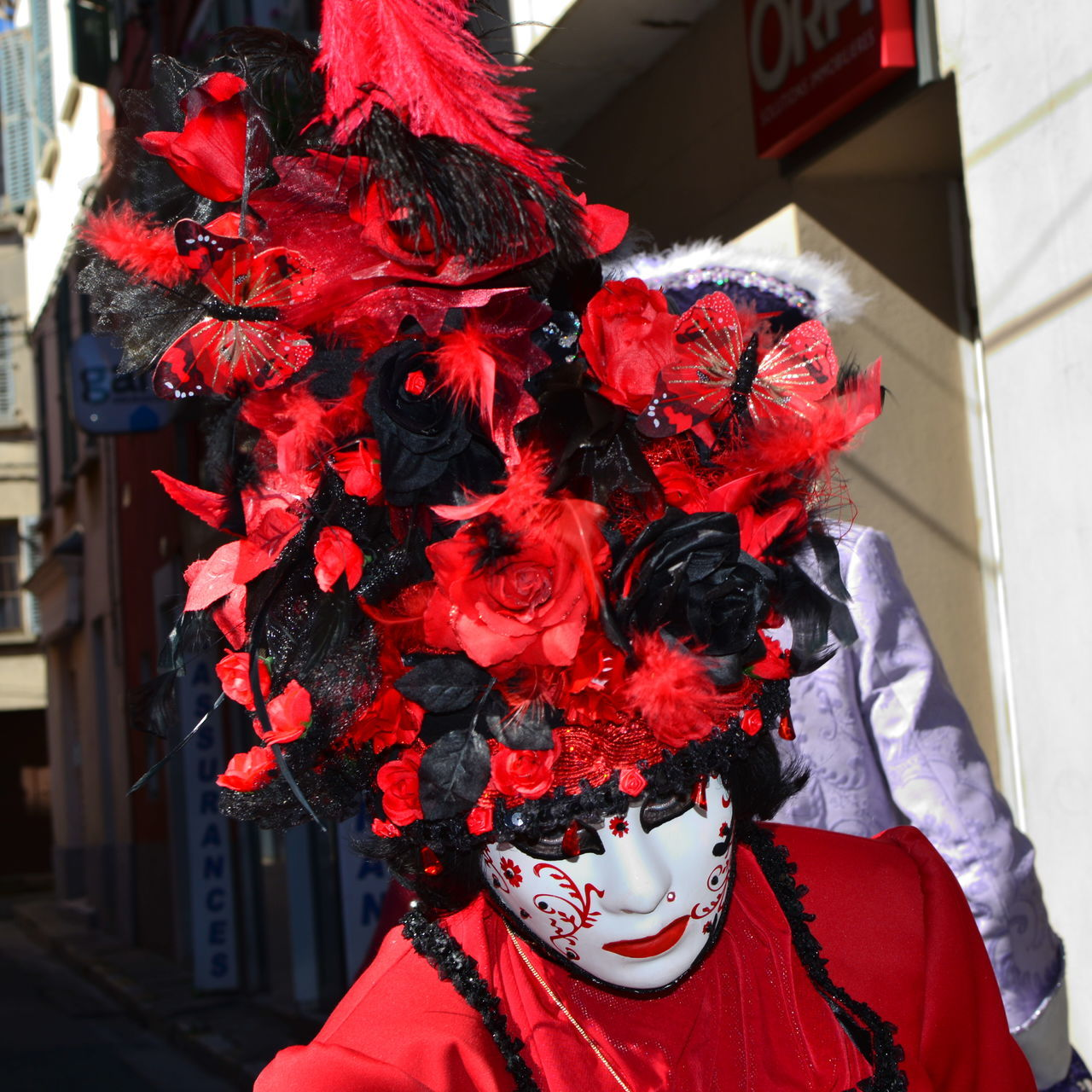 red, costume, real people, celebration, mask - disguise, carnival, leisure activity, venetian mask, one person, wearing, outdoors, men, day, flower