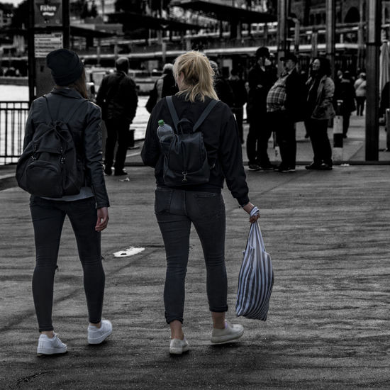 two woman Adult Adults Only Casual Clothing City Day Elbe River Full Length Hamburg Harbour Landungsbrücken  Leisure Activity Lifestyles Men Outdoors People Real People Rear View Standing Togetherness Two People Two Woman Walking Warm Clothing Women