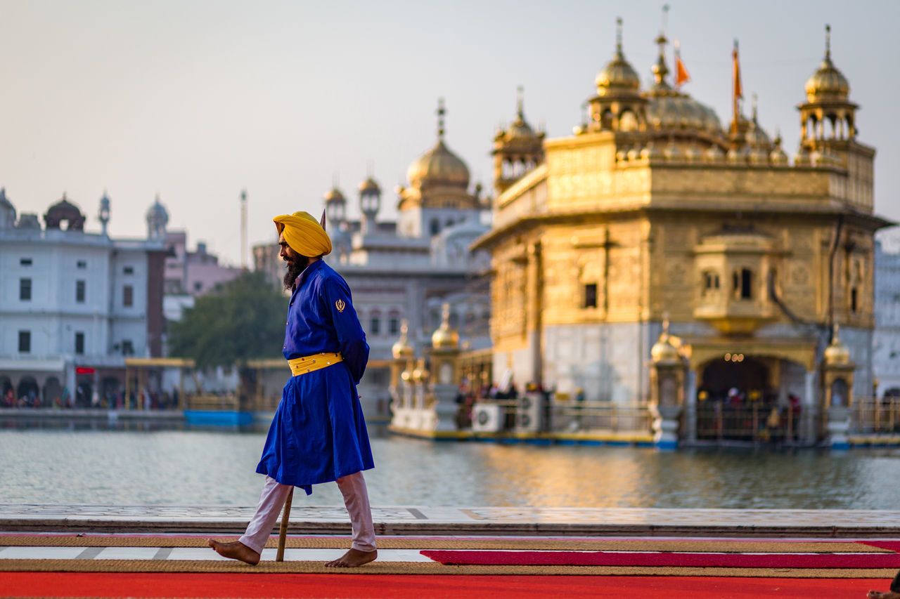Sikh Guard at the Golden Temple, Harmandir Sahib, in Amritsar, India Amritsar Architecture Blurred Golden Golden Temple Guard Harmandir Sahib Headwear India One Person Outdoors People Punjab Security Sikh Sikhism Temple Traditional Clothing Turban