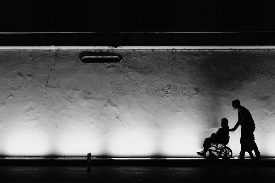 People Love TakeCare  Family Darkness And Light Blackandwhite Black And White Photography Bangkok Thailand Momandson Walking Nightphotography Two People Shadows & Lights WatPhraKaew Streetviewphotography First Eyeem Photo