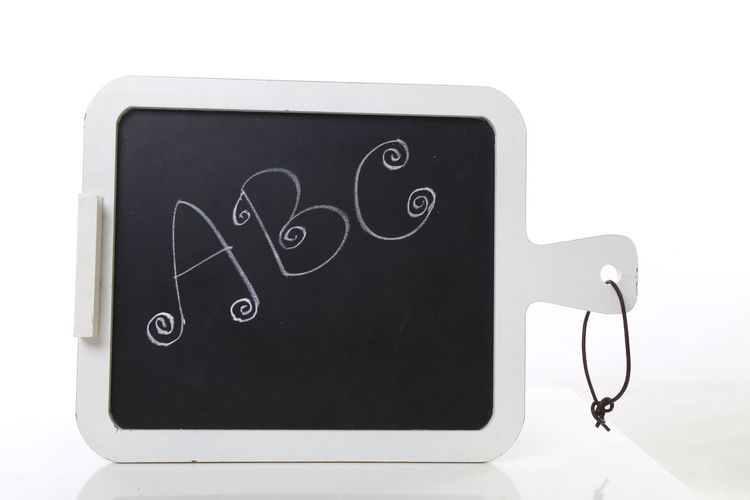 hand written ABC letters on a blackboard Chalk Board Blackboard  Close-up Day Hand Writing Indoors  No People White Background
