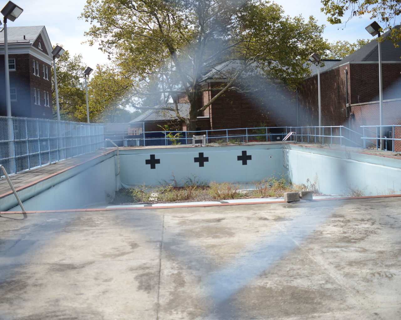 architecture, built structure, building exterior, tree, water, swimming pool, day, outdoors, motion, sport, no people, skateboard park, competitive sport