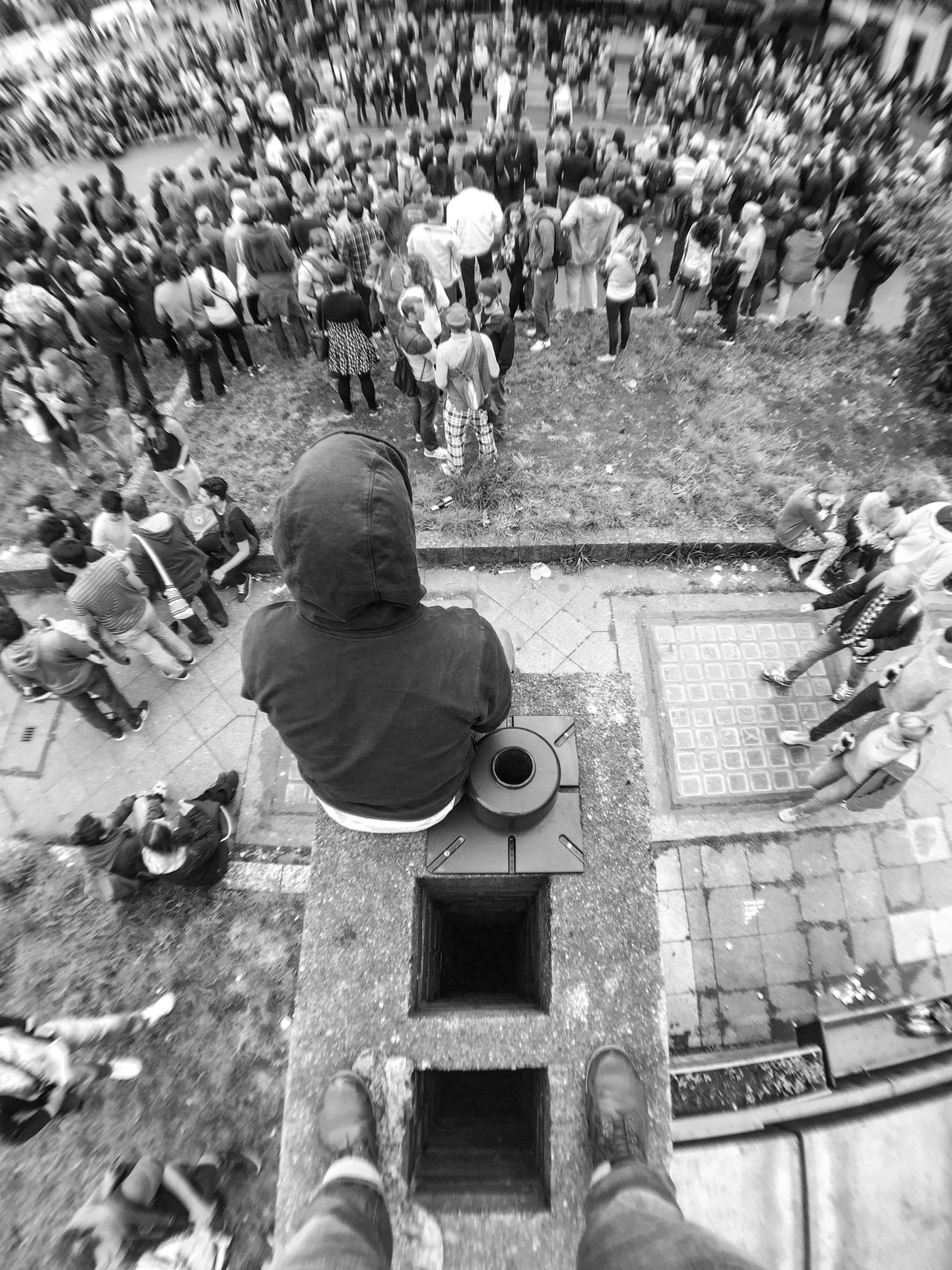 Looking down on the crowd Adult Adults Only Berlin Black And White Day High Angle View Karneval Der Kulturen Men Nature Outdoors People Real People Rear View Sitting