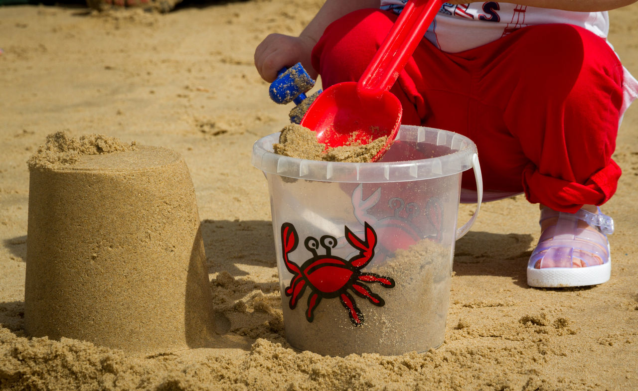 Baby Beach Beach Life Buckets Day Freshness Holidays Outdoors Part Of The Body Playing At The Beach Playing With Sand Sand Sand Castle Summer Toddler  Toddlerlife