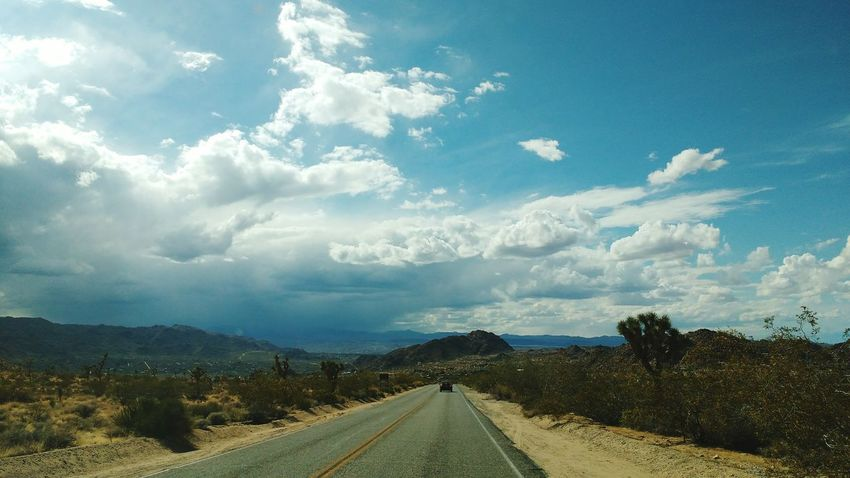 Vacation Destination Dry Climate Clouds Cloud California Joshua Tree Road Mountains Sky And Clouds Deserts Around The World Desert Beauty Desert Cactus Cactus Tree The Great Outdoors - 2016 EyeEm Awards Let's Go. Together. The Way Forward Transportation Cloud - Sky Mountain Tranquility Scenics Nature Landscape Day No People Sky Outdoors Beauty In Nature Tree