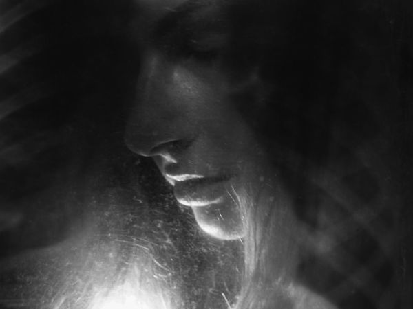 Portrait through an old xray Black & White Black And White Close-up Human Body Part Human Face Human Lips Portrait Real People Ribs Xray Xrayart Young Women EyeEmNewHere EyeEmNewHere