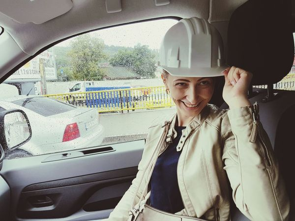 One Woman Only Headwear Transportation Business Finance And Industry Hardhat  Safety Helmet Construction Worker Beautiful Woman Fooling Around Having Fun In Car Shot Rainy Day Smiling Woman Smiling Crash Helmet Construction Equipment PhonePhotography Me Having Fun EyeEmNewHere Investing In Quality Of Life Car Be. Ready.
