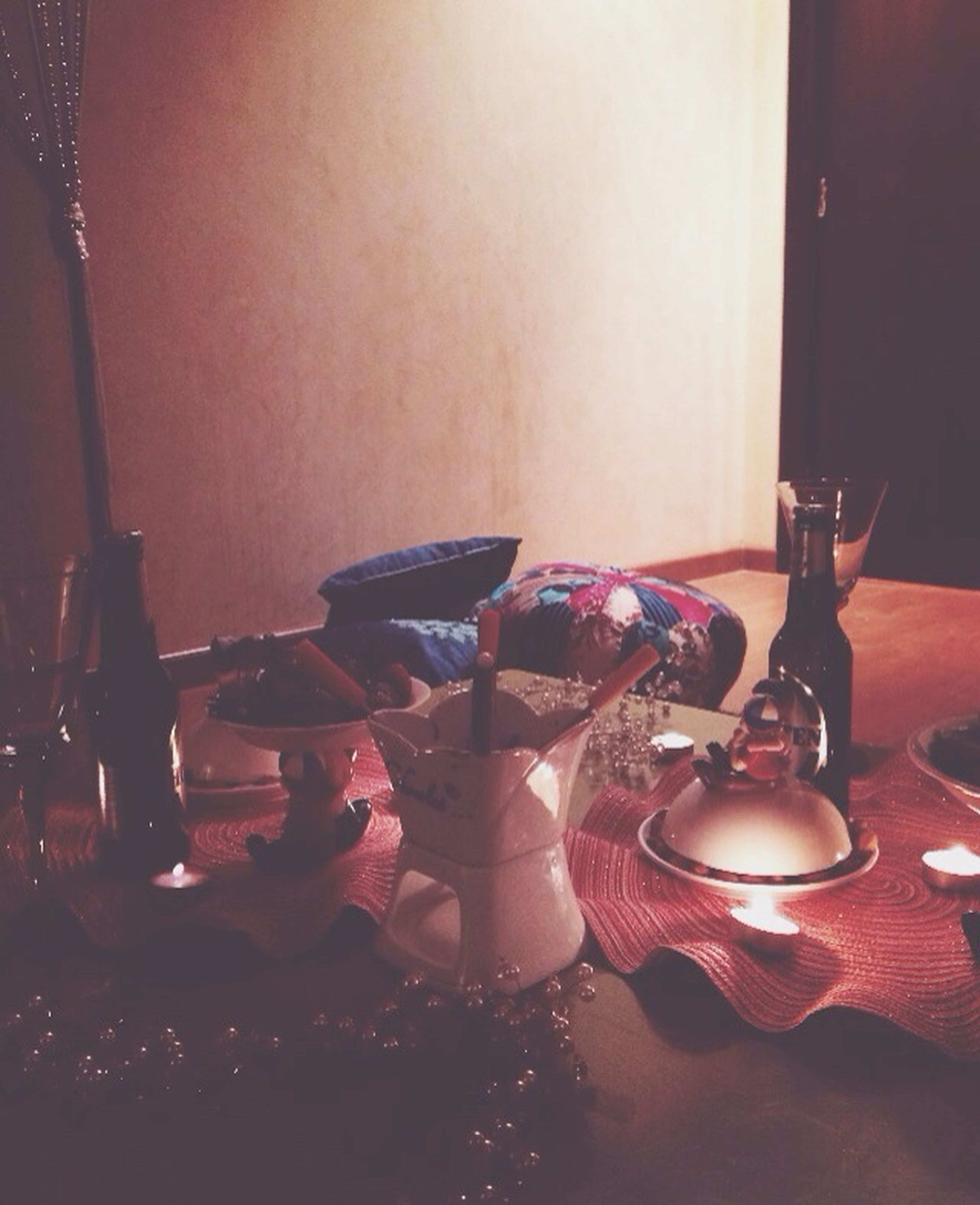 indoors, table, home interior, wineglass, chair, restaurant, illuminated, still life, candle, drinking glass, glass - material, food and drink, absence, drink, lighting equipment, close-up, wine, celebration, dining table, curtain