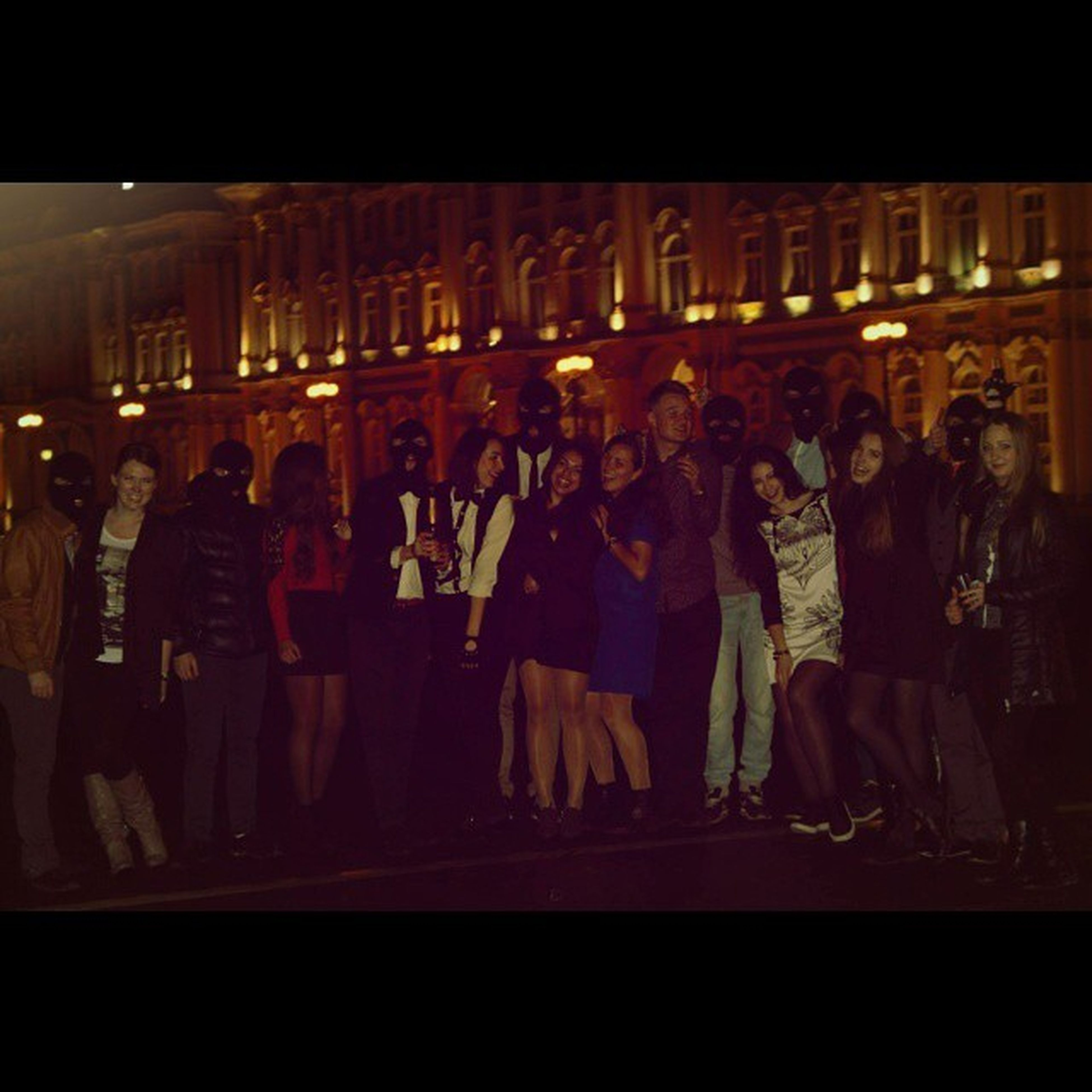 indoors, men, person, lifestyles, standing, night, illuminated, in a row, large group of people, side by side, walking, leisure activity, rear view, group of people, medium group of people, built structure, architecture, dark, full length