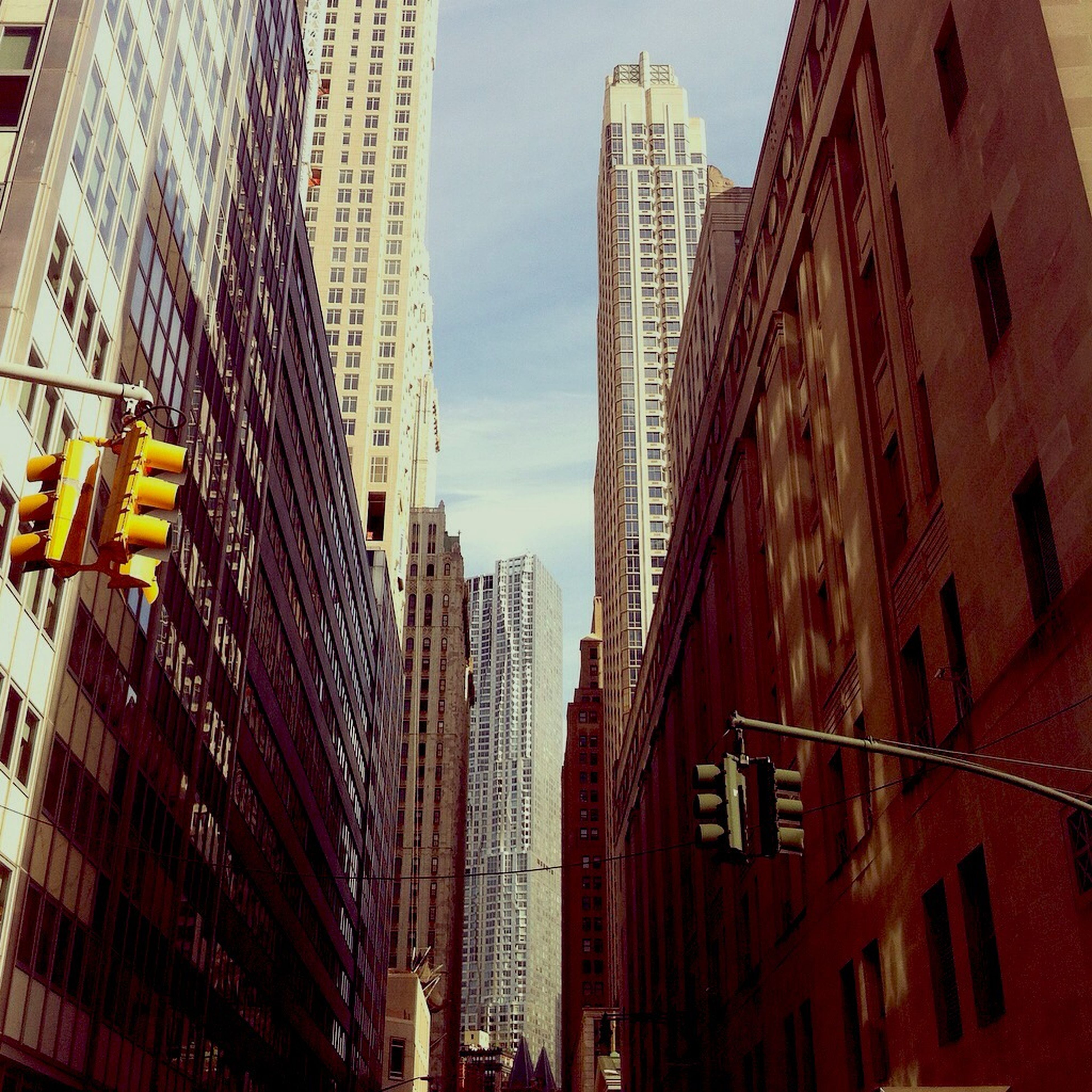 building exterior, architecture, built structure, city, skyscraper, office building, low angle view, tall - high, modern, tower, building, city life, residential building, sky, day, tall, outdoors, no people, clear sky, residential structure