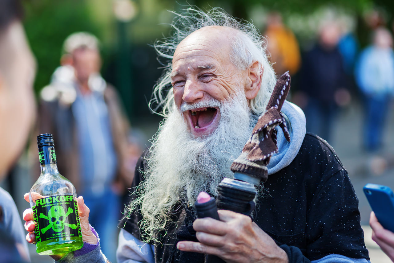 funny old man at the Carnival of Cultures in Berlin, Germany Alcohol Bearded Bearded Man Berlin Carnival Of Cultures Carnival Of Cultures Berlin City City Life Close-up Day Focus On Foreground Funny Funny Faces Germany Laughing Lifestyles Men Old Man Outdoors People Real People Senior Street Photography