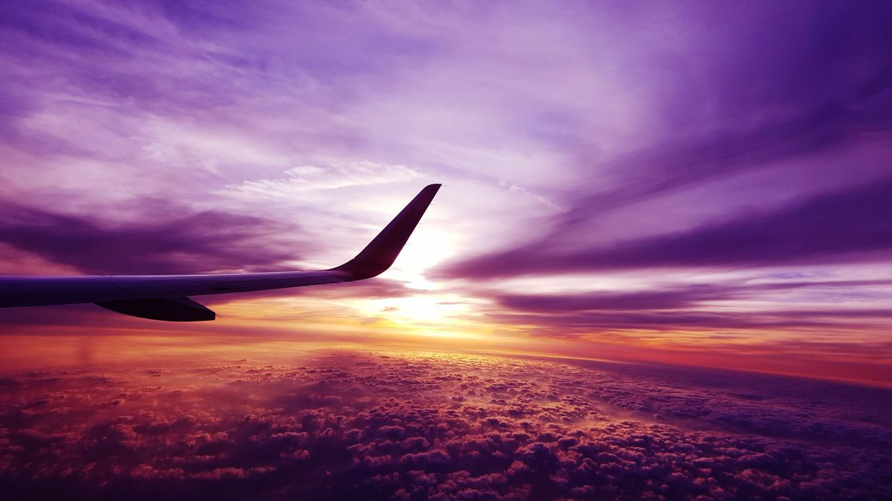 Flying in the sky Airplane Flying Sky Transportation Aircraft Wing Travel Nature Beauty In Nature Sunset Cloud - Sky Journey Airplane Wing No People Air Vehicle Outdoors Day EyeEmNewHere Purple Clouds And Sky Cloud High Trip EyeEmNewHere