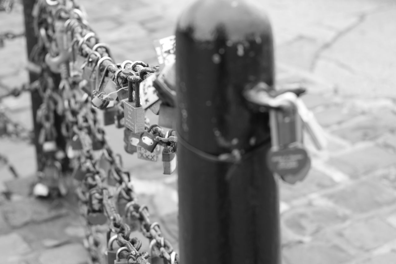 Blackandwhite Close-up Day Focus On Foreground Human Body Part Lifestyles Locks Love Monochrome Monochrome Photography No People Outdoors Protection Safety Water
