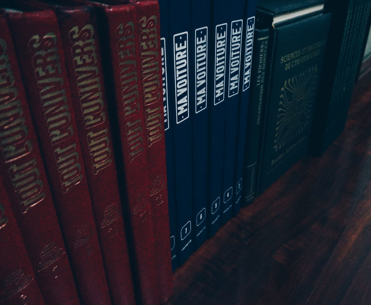 text, book, western script, number, communication, indoors, in a row, education, library, no people, literature, data, arrangement, alphabet, information medium, stack, close-up, bookshelf, day