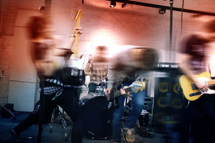 Happy Metal Band Rock Blurred Motion Concert,punk Crowd Enjoying Life Indoors  Large Group Of People Lifestyles Men Motion Night Occupation People Punk Band Real People Riot Uniform