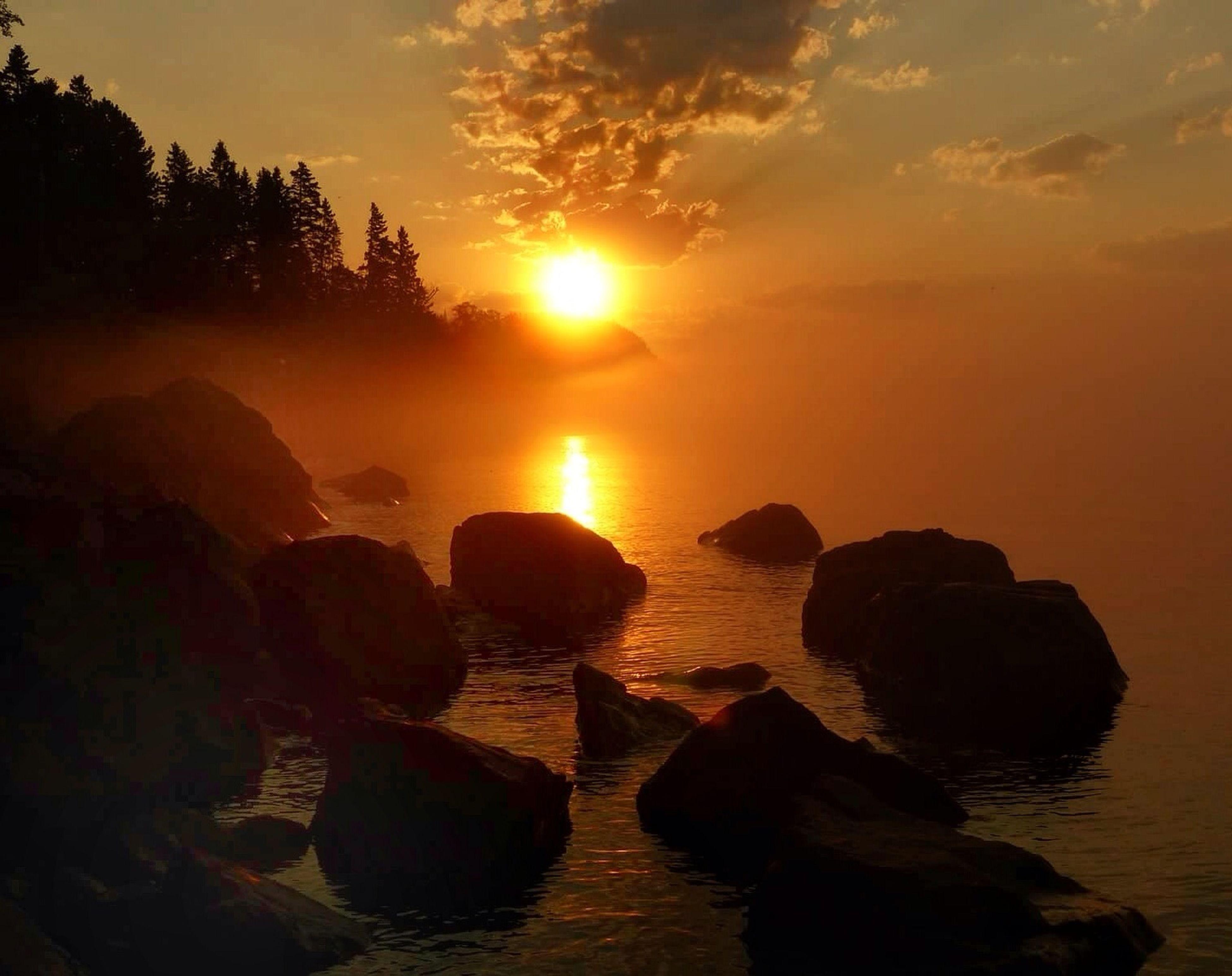 sunset, water, sky, sun, scenics, orange color, tranquil scene, tranquility, reflection, beauty in nature, silhouette, nature, idyllic, cloud - sky, sunlight, outdoors, cloud, sea, non-urban scene, lake