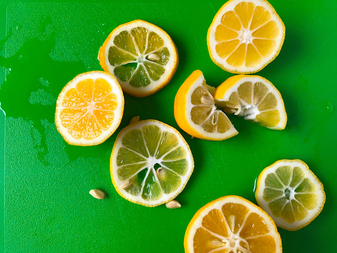 Lemon slices from overhead Copy Space Green Natural Light Seeds Citrus Fruit Close-up Cross Section Cutting Board Day Food Food Ingredient Freshness Indoors  Juicy Lemons No People Overhead Phone Camera Room For Text Slices Sour Taste Vitamin C Yellow