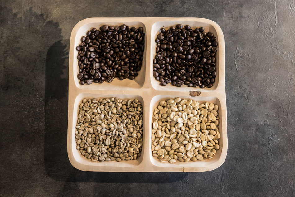 Four types of coffee beans top view Bean Black Brown, Caffeine Coffee Coffee Bean Coffee, Culture Dark, Espresso Food Freshness High Angle View Horizontal Indoors  No People Raw Coffee Bean Roasted Seeds Square Top View
