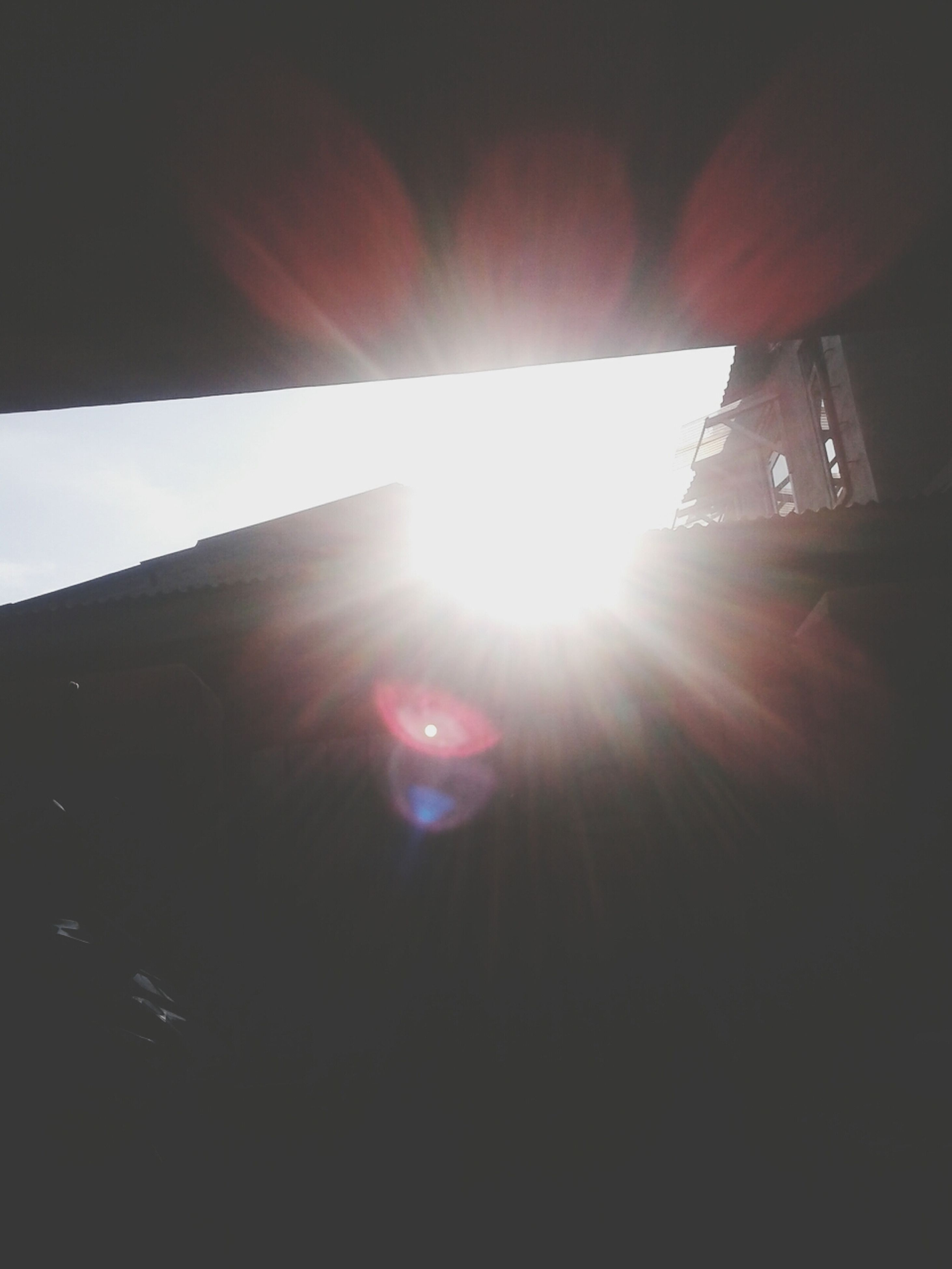 sun, sunbeam, lens flare, sunlight, bright, low angle view, sunny, transportation, built structure, sky, architecture, window, brightly lit, day, mode of transport, car, building exterior, glass - material, no people, outdoors