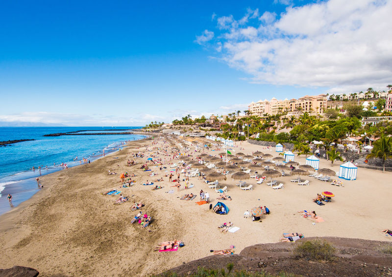 Picturesque El Duque beach in Tenerife. Canary islands, Spain Atlantic Ocean Canary Islands El Duque Beach Rocky Coastline SPAIN Seashore Beach Beauty In Nature Cliff Cloud - Sky Crowd Of People Day Landscape Nature Ocean Outdoors Picturesque Scenery Sea Seaside Sky Sunbathing Sunny Day Tenerife Travel Destinations