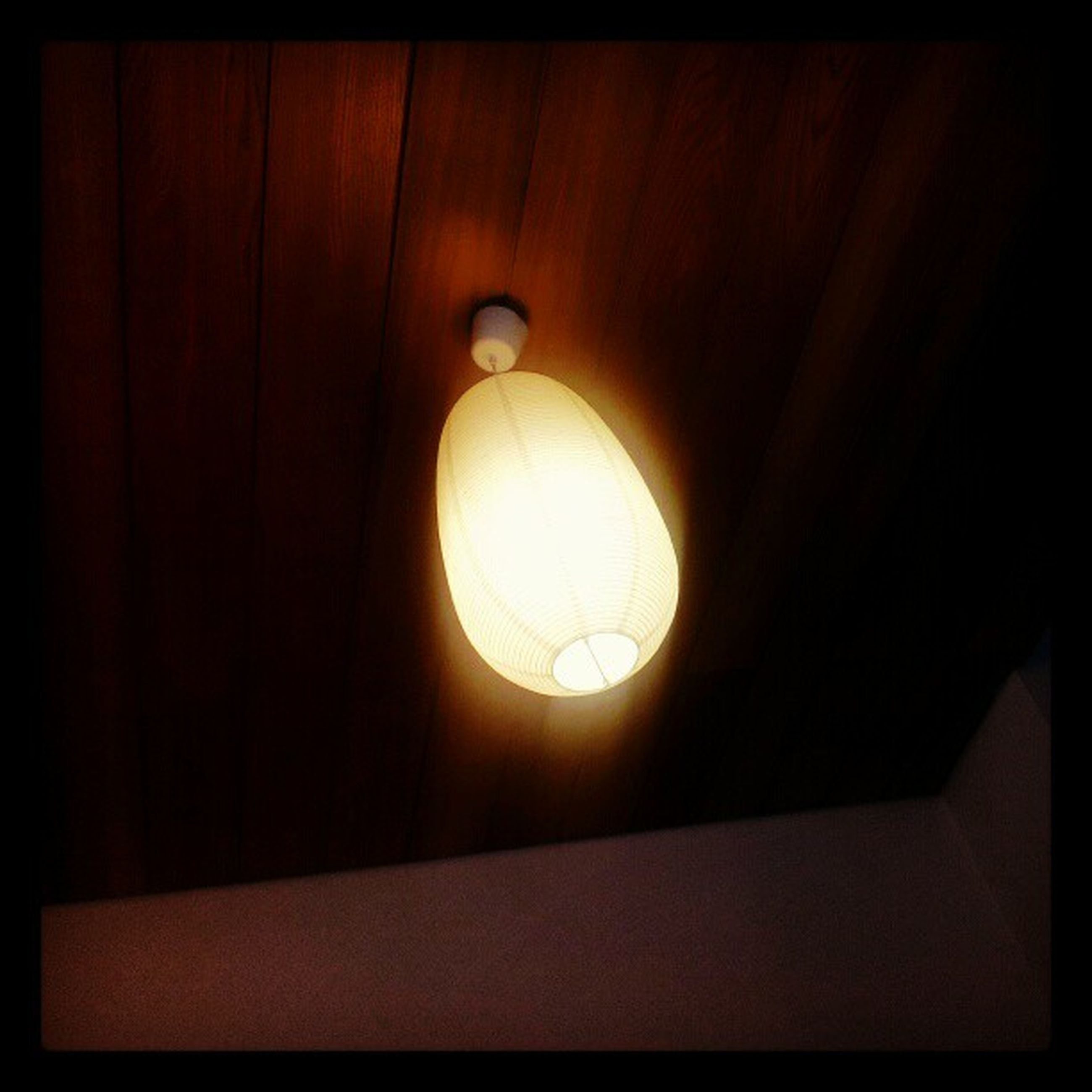 indoors, lighting equipment, illuminated, electricity, ceiling, low angle view, electric lamp, hanging, electric light, light bulb, home interior, glowing, light - natural phenomenon, built structure, lamp, dark, no people, close-up, pattern, geometric shape