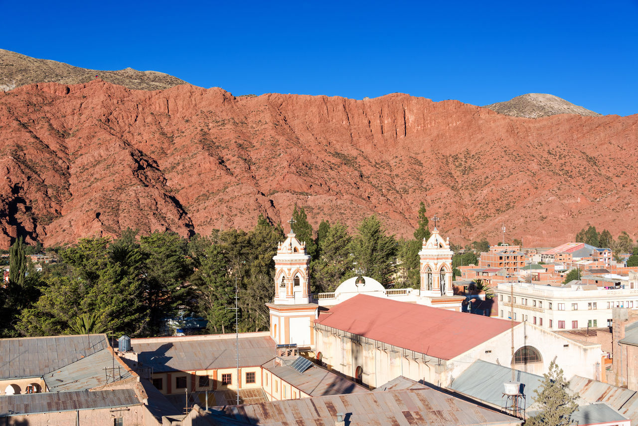 Cathedral of Tupiza, Bolivia with beautiful red hills rising in the background Amazing Andes Beauty Bolivia Cactus Canyon Church Color Countryside Desert Destination Formation Formations High Hills Landscape Mountain Nature Rock Rocks South America Town Travel TUPIZA Valley