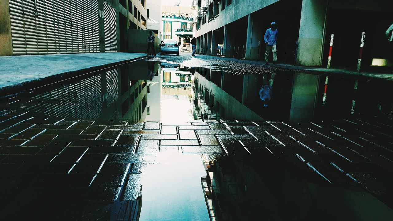 After rain ☔ Reflection Water Built Structure Architecture Building Exterior Outdoors Day No People Puddle Weather Photography Low Angle View PhonePhotography EyeEmNewHere