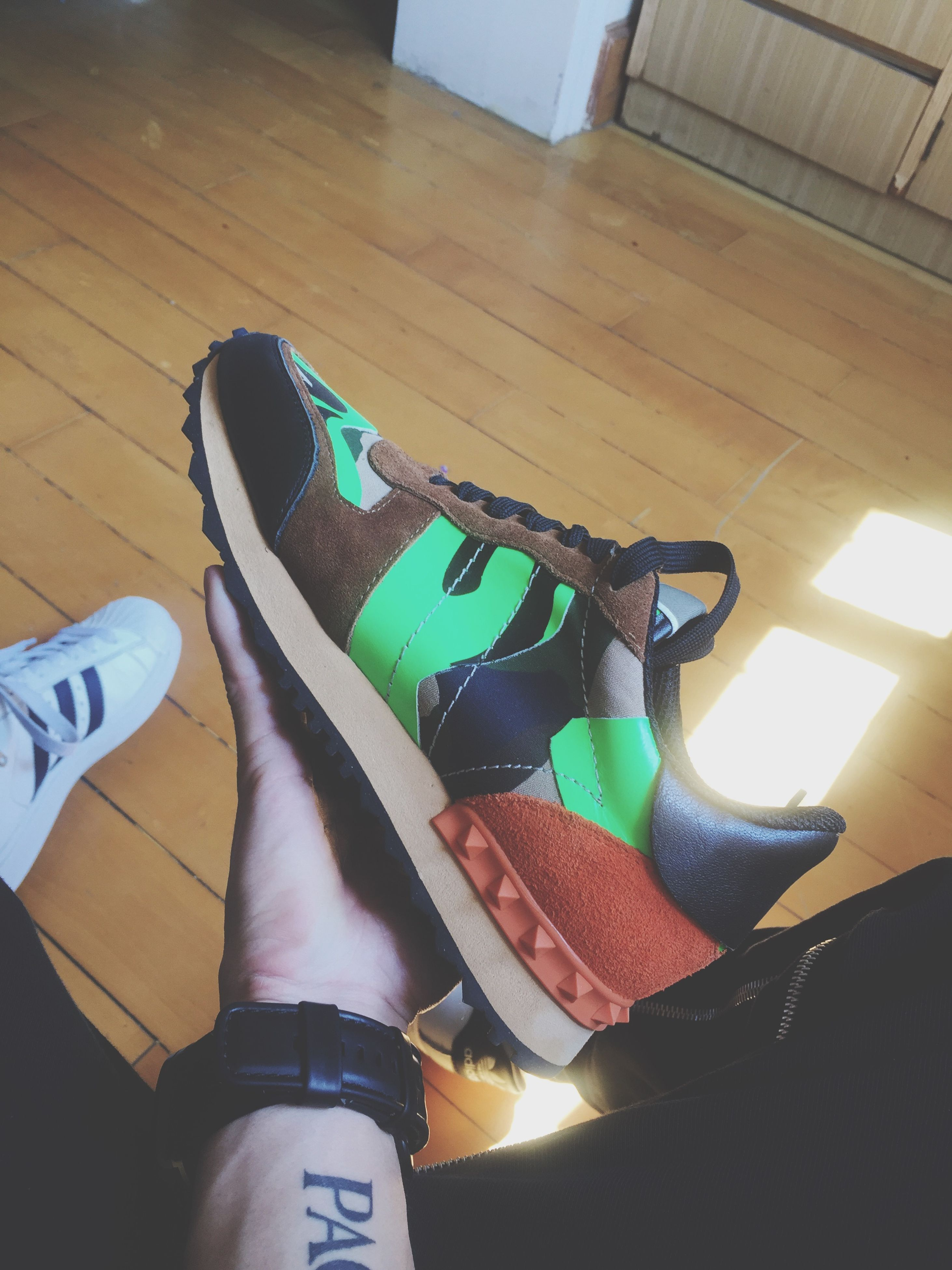 shoe, indoors, low section, high angle view, personal perspective, person, leisure activity, lifestyles, footwear, close-up, men, arts culture and entertainment, multi colored, part of, unrecognizable person, sunlight, music
