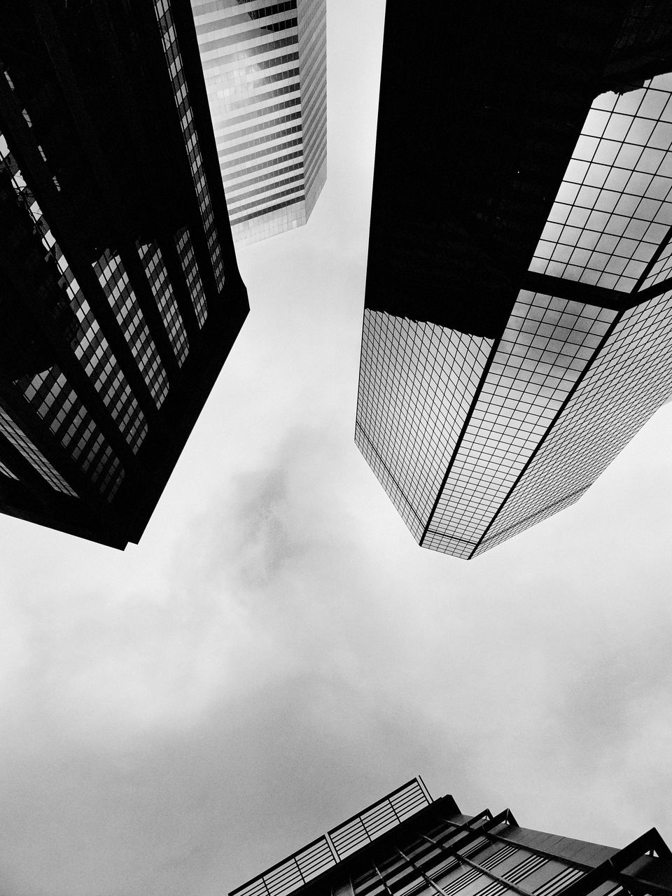 architecture, building exterior, low angle view, built structure, city, skyscraper, sky, day, no people, outdoors, growth, tall, modern