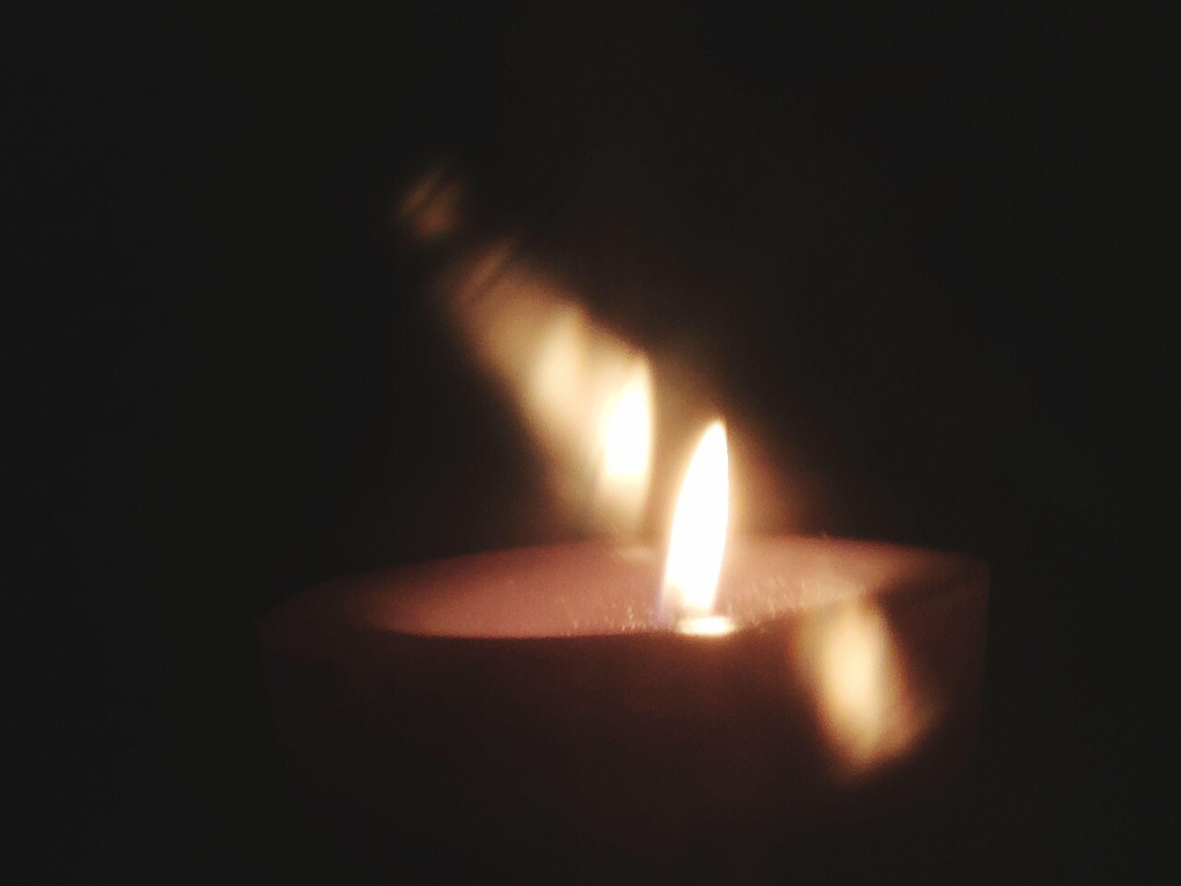 flame, burning, heat - temperature, glowing, fire - natural phenomenon, illuminated, dark, copy space, darkroom, candle, lit, indoors, night, black background, close-up, studio shot, fire, light - natural phenomenon, lighting equipment, candlelight