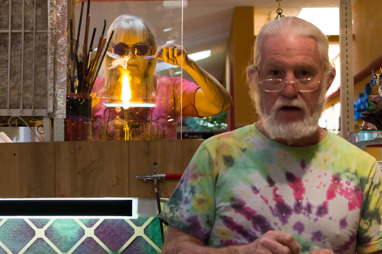 Artist Casual Clothing Facial Expression Fire Flame Foothills Mall Glass Hippie Hippielife Indoors  Looking At Camera Melting Retail  Tyedye Waist Up