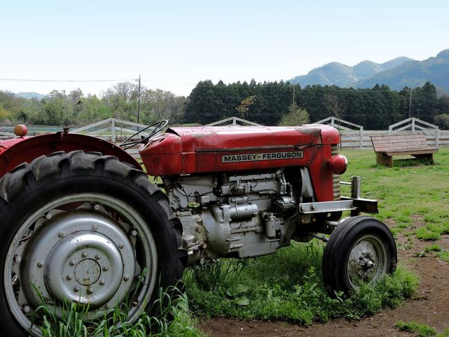 Agricultural Machinery Country Scenery Farm Field Grass Mountain No People Non-urban Scene Outdoors Red Tractor