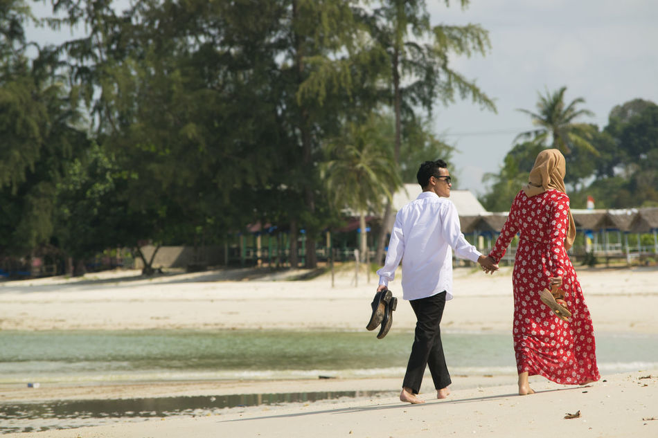 Trikora Beach Enjoy The New Normal Beach Moments Candid Couple Beyonce Relationship Nature Landscape Beauty In Nature Beachphotography Romantic Sky Romantic Romantic❤ Couples Outdoors Traveling My Year My View Traveling Home For The Holidays