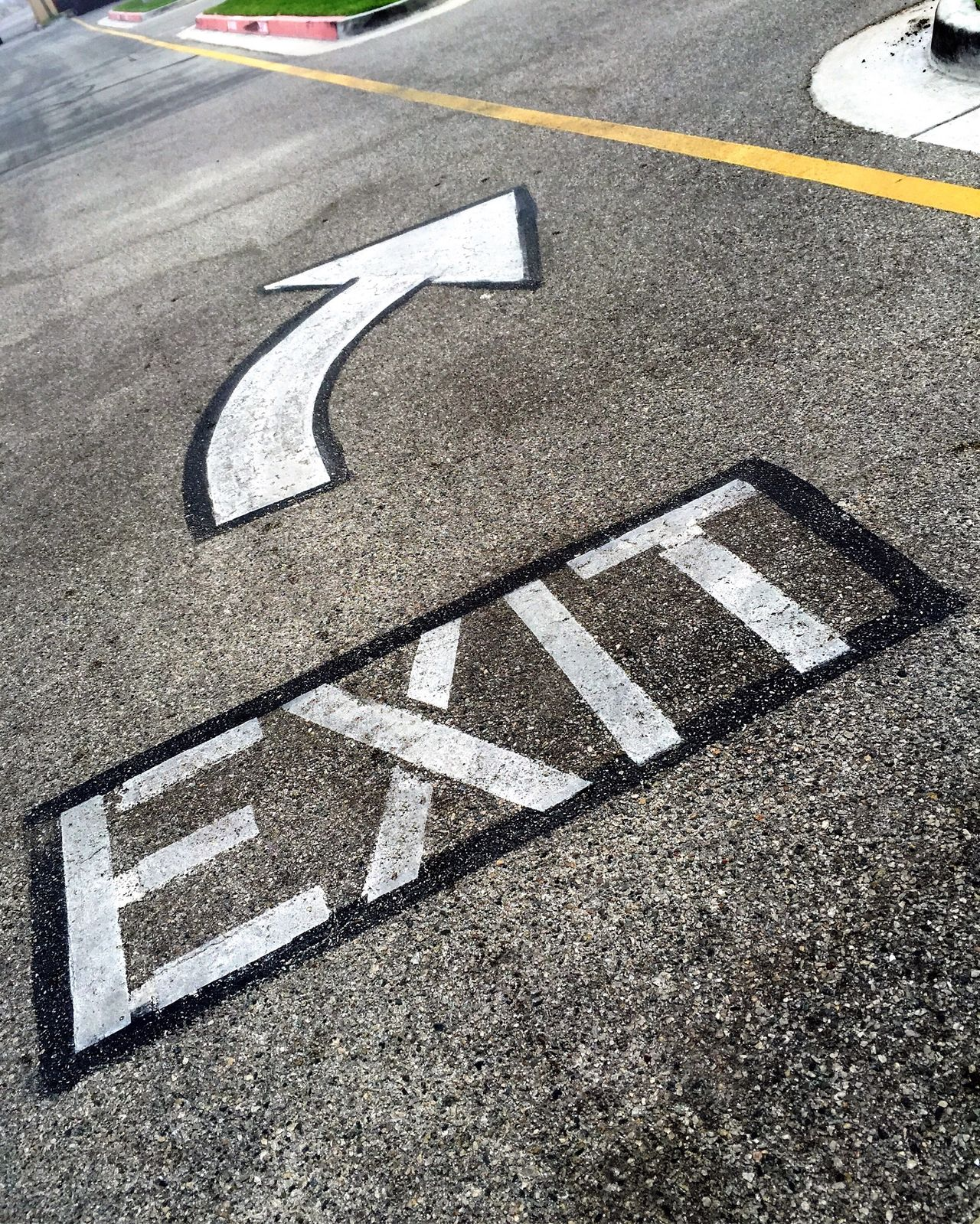 Painted exit sign and arrow on the street pavement Arrow Arrow Sign Arrows Asphalt Asphalt Communication Direction Directional Sign Directions Exit Exit Sign No People Out Outdoors Painted Arrow Painted Sign Pavement Road Road Sign Road Signs Street Street Sign Street Signs This Way This Way Out