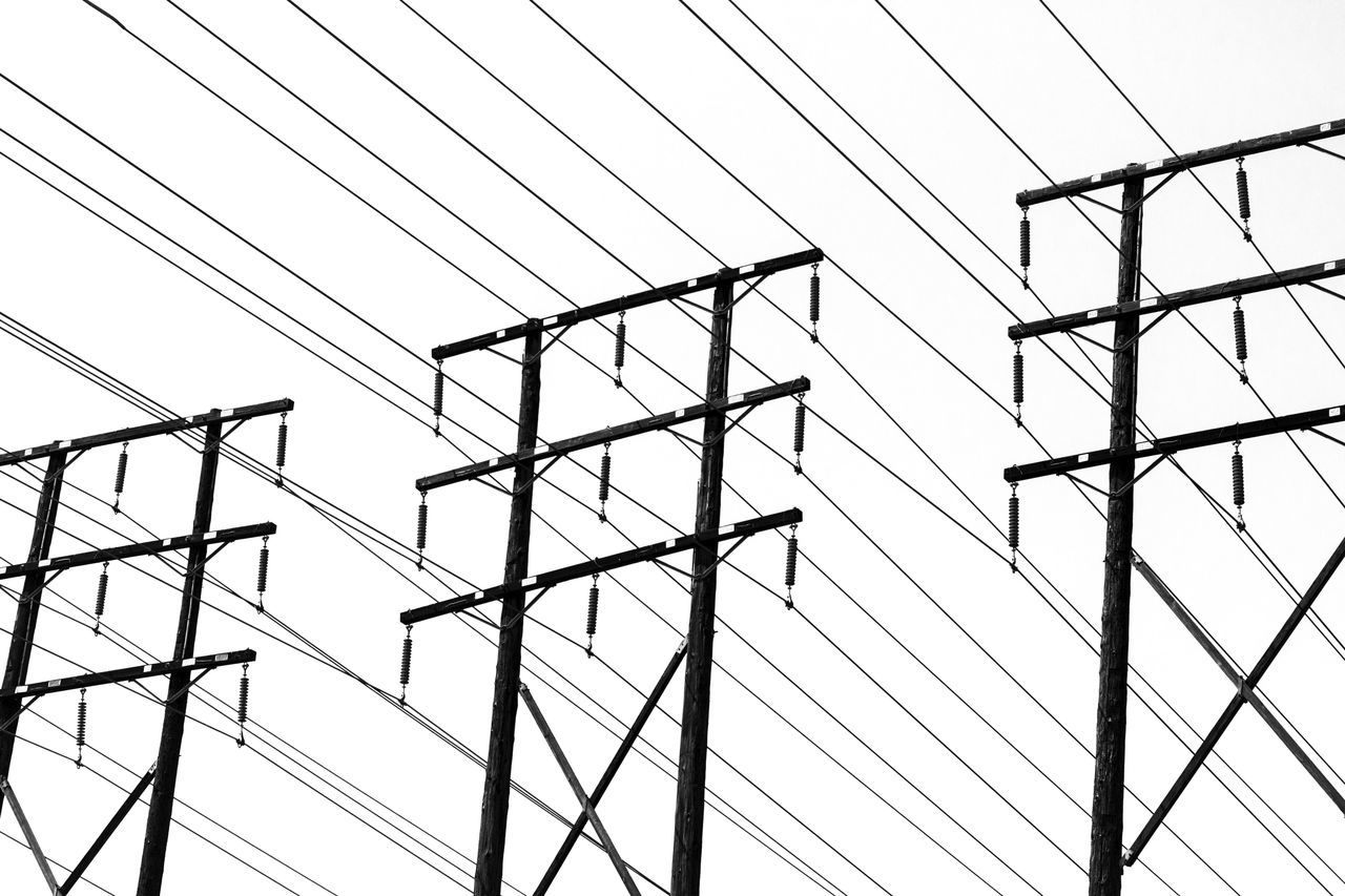 Blackandwhite Built Structure Cable Complexity Connection Contrast Day Electricity  Electricity Pylon Lines Low Angle View Monochrome Nature No People Outdoors Pattern Power Supply Shapes Sky Structure