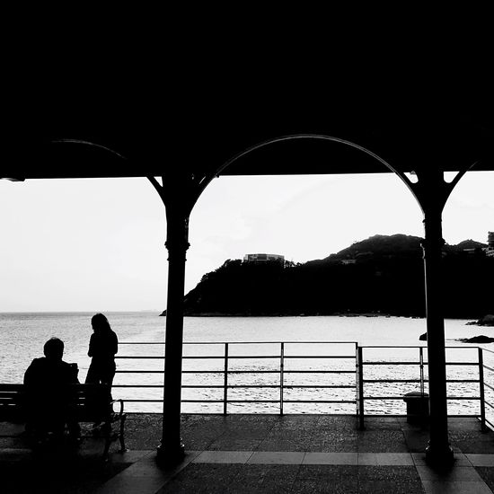 Water Two People Sitting Sea Rear View Real People Togetherness Men Relaxation Silhouette Leisure Activity Full Length Day Looking At View Lifestyles Women Below Nature Beauty In Nature Outdoors Black And White Friday