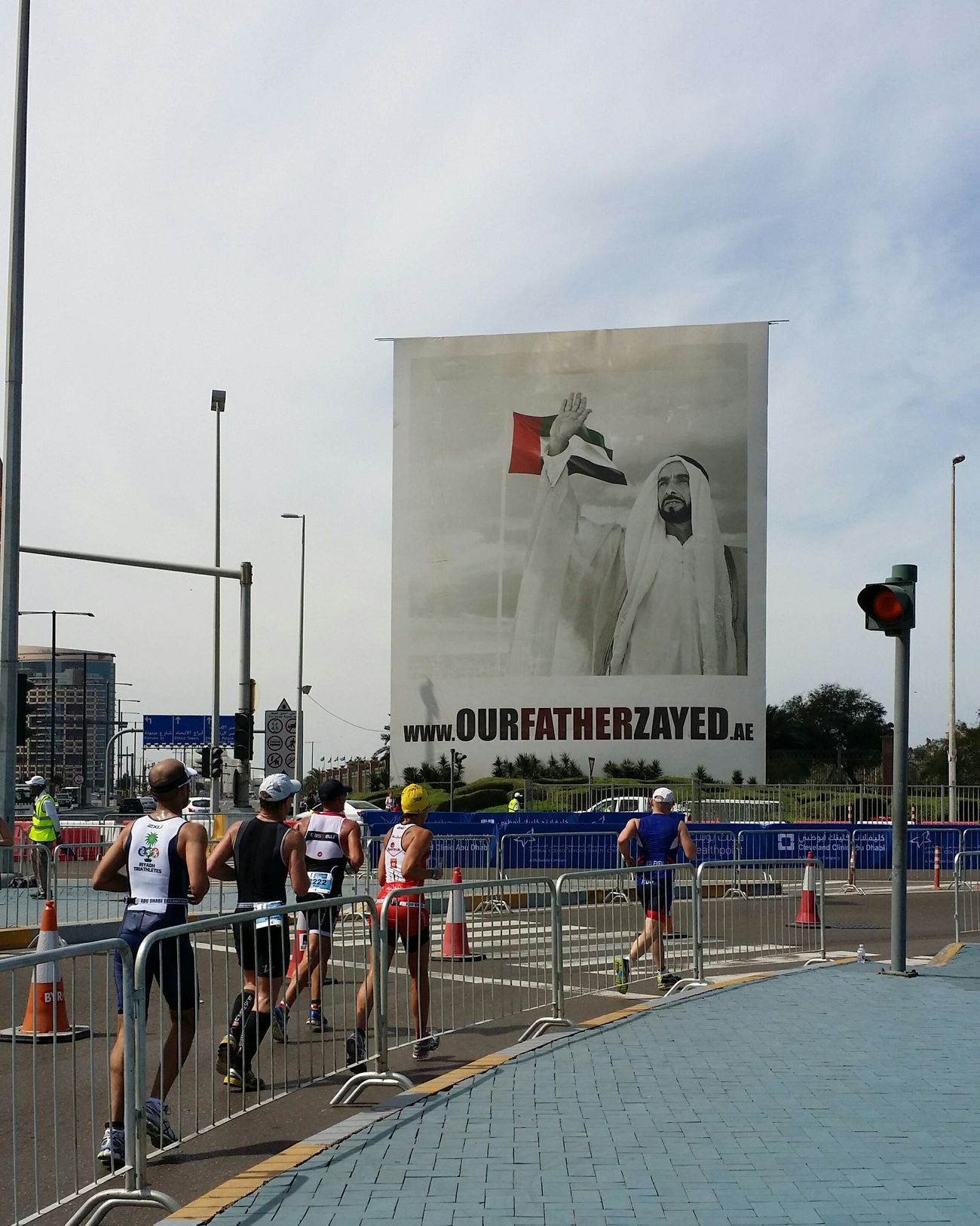 Uae,abudhabi International TRIATHLON Championshipat Corniche Abudhabi. The portrait is of late Sheikh_Zayed the fouder of the United Arab Emirates may Allah bless his soul.