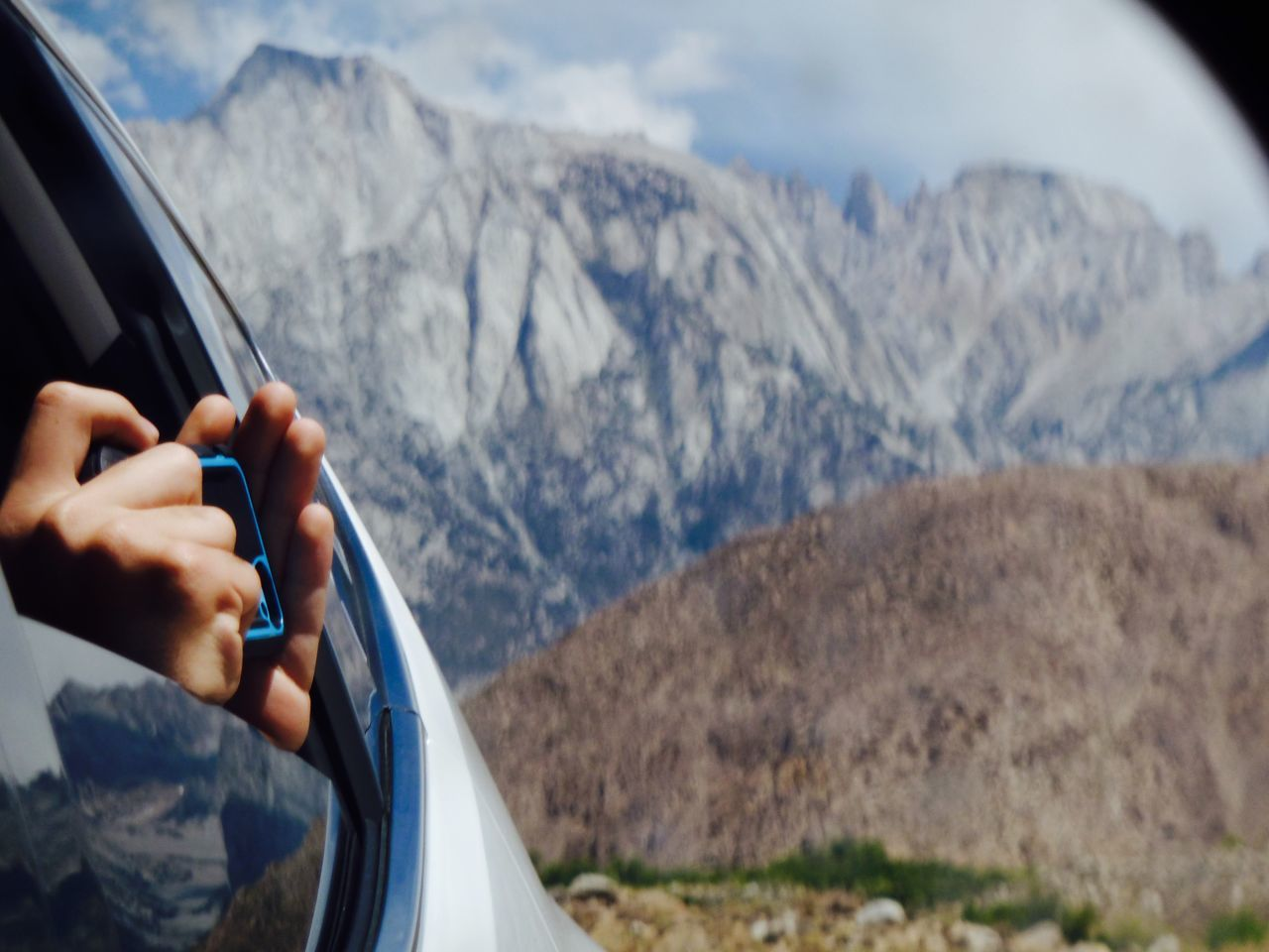 Documenting Travel Hands Holding Camera In Moving Car Mt. Whitney High Sierra Hands Holding Camera Reflections In Car Windows Landscapes Mountain Mountains In Background Scenics Sierra Nevada Mountains Taking Photos Travel Joy Of Travel Road Trip Exploring California Whitney Portal Road