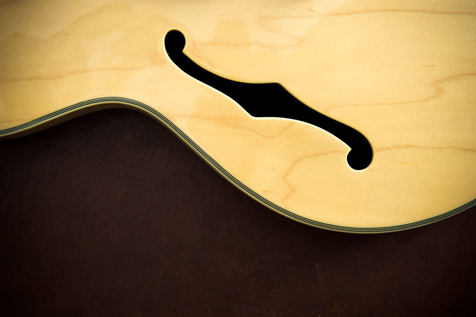 Electric guitar body and f-hole detail Close-up Electric Guitar F-hole Guitar Guitar Body Indoors  Musical Instrument No People Part Of Sound Stringed Wooden