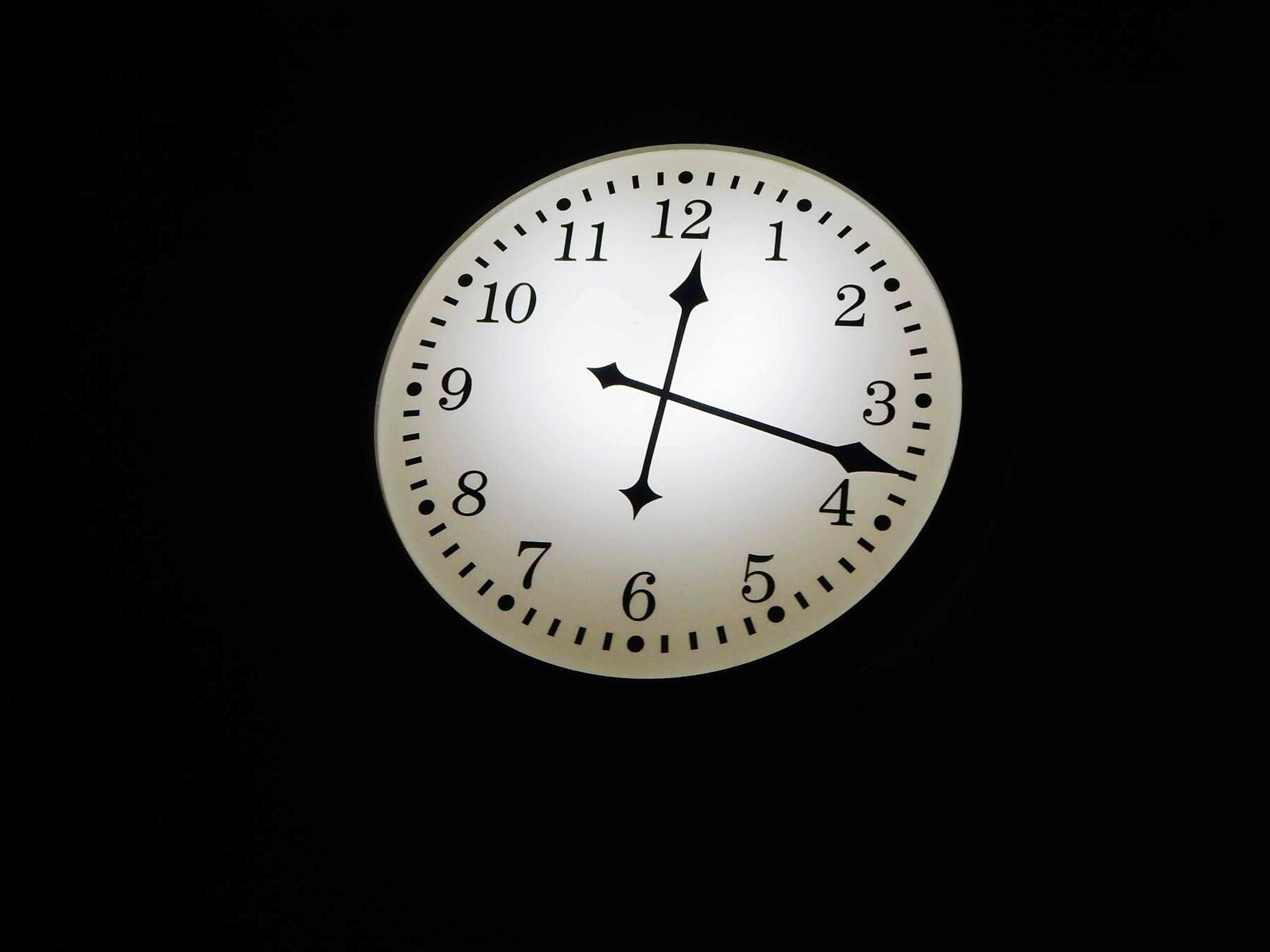 time, number, clock, minute hand, clock face, black background, hour hand, no people, indoors, studio shot, night, close-up, technology