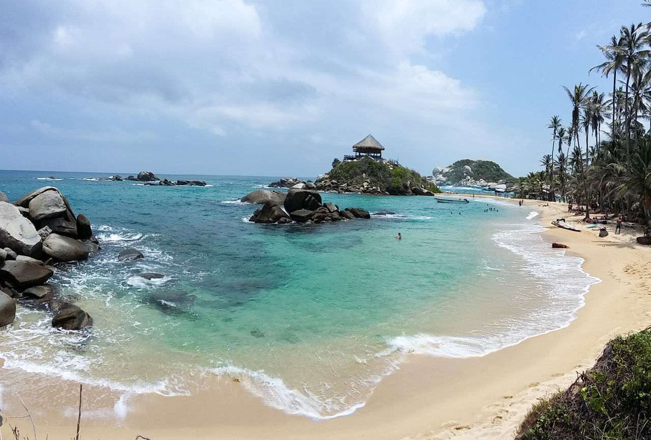 Cabo San Juan | Parque Tayrona Sea Water Beach Sky Tranquility Panoramic Beauty In Nature Tree Nature Blue Cloud - Sky Travel CaboSanJuandelGuía ParqueTayrona Santamarta